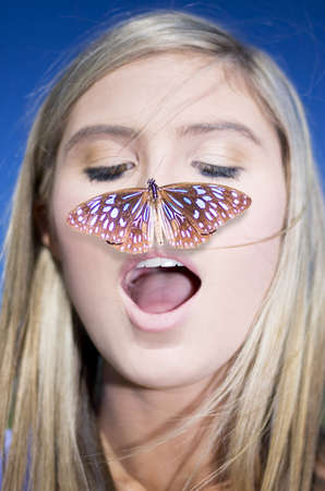 Nature Connection Concept Showing A Head Shot Of An Attractive Blond Woman With A Butterfly On Her Nose photo