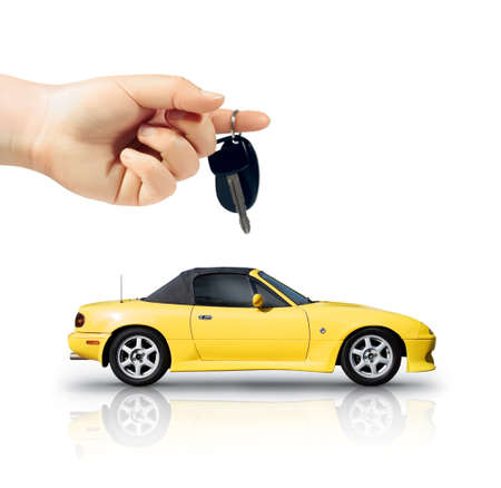Isolated Studio Portrait Of A Female Hand Holding The Key To Unlock A Yellow Sports Car In A Transport And Travel Conceptual Isolated On White Background photo