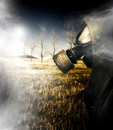 Death Wafting Through The Air Of A Dead Field With A Ukrainian Soldier In Millitary Issued Gas Mask Walking Past After A Nuclear Holocaust Terrorist Attack photo