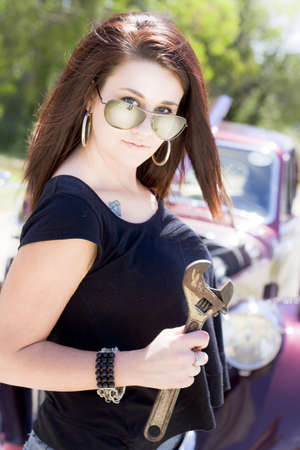 Sexy Mechanic Lady Wearing Sun Shades And Holding Adjustable Spanner About To Fix And Service An Old Classic Car Stock Photo - 12864755