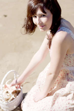A Woman Visits The Great Outdoor To Collect Sea Shells And Discover The Beauty In Nature photo