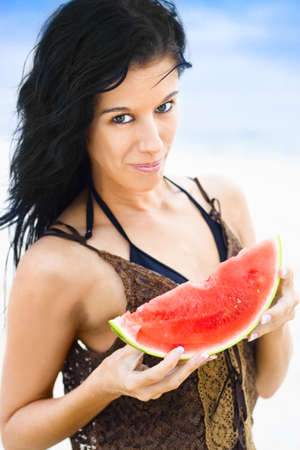 Attractive Bikini Woman Holding A Slice Of Pink Juicy Watermelon Smiling With Expression Of Contentedness And Happiness As If She Loves The Watermelon Stock Photo - 12864836
