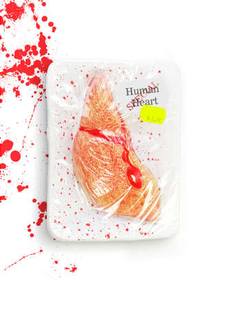 Bloody, Bruised And Battered, A Human Heart Is On Special At The Meat Market Of Lonely Hearts Stock Photo - 12864939
