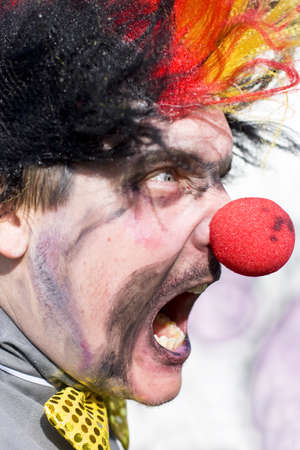 Madness The Man Clown Screams In An Angry Fit Of Furious Rage Stock Photo - 12864962