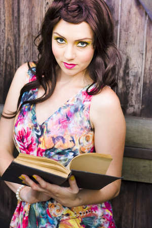 In A Research And Education Effort A Young Pretty Woman Reads And Studies An Open Knowledge Booklet In An Attempt To Learn And Discover Information And Facts Stock Photo - 12863699