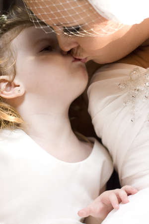 Family Love With A Bride Kissing Her Daughter In A Touching And Special Moving Marriage Moment photo