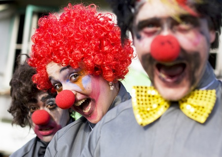Focus On The Faces Of 3 Crazy Circus Clowns At An Outdoor Birthday Gig Clowning Around In A Funny And Comical Show Of Entertainment Stock Photo - 12864543