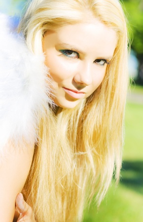 Closeup On A Young Attractive Female Angel Looking Oncamera With A Gaze Of Purity And Innocence In A Angel Face Conceptual Stock Photo - 12807535