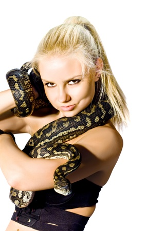 Danger, Caution And Concern Slither Along A Gorgeous Blond Womans Arm While Holding A Python Snake, Studio Photo Isolated On White Background photo