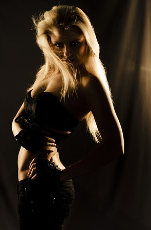 Charming, Charismatic And Beautiful Blonde Dancer Moving Mysteriously In The Deep Shadows Of Darkness During A Elegant And Sexy Dance Of Mystique Stock Photo - 12807502