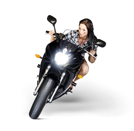 Studio Photograph Of A Good Looking Woman Riding A Motorbike Or Motorcycle Around A Corner With Headlights On In A Need For Speed Concept Isolated On White photo