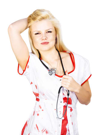 sexy blonde nurse wearing white uniform holding the stethoscope hanging from neck, with the other hand holding hair up on a white background Stock Photo - 12863328