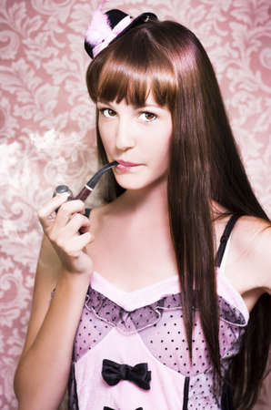 Pink Tone Photograph Of A Attractive Film Actress Smoking A Pipe Indoors Against Retro Wallpaper photo