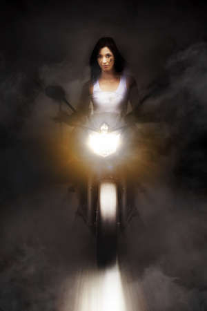 Artistic Photo Of A Person Riding A Motorcycle On A Dark Foggy Road At Speed With Headlights On High Beam In A Highway Race Conceptual photo