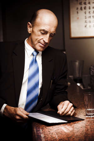 Senior Business Man Placing Order At The Counter Of A Asian Restaurant In A Chinese Dining And Takeaway Conceptual Stock Photo - 13037106