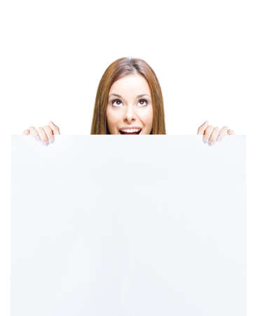 Surprised Shocked Business Marketing Woman Holding Blank On White Sign, Empty Notice Or Clear Board With Copyspace In A Cute Funny Sales And Advertising Concept photo
