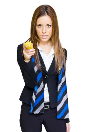 Sexy Business Woman Holding Up A Banana And Taking Aim To Shoot With A Deadly And Confident Look Of Determination When Going Bannanas Over Business, On White Stock Photo - 13126222