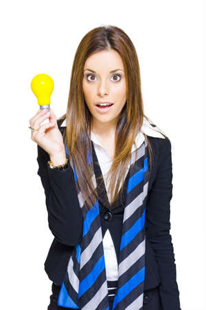 Cute Surprised Female Business Person Holding A Lightbulb Solution In Hand With A Look Of Discovery Knowledge And Creativity, Isolated On White Background  Stock Photo - 13126415