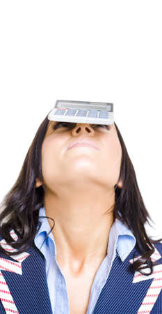 Studio Portrait Of An Account Keeping Business Woman Balancing A Calculator On Head In A Profit Loss Tax And Accounts Concepts Titled Balancing Finance Accounts photo