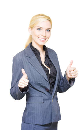 Isolated Studio Portrait Of A Young Blond Business Woman Gesturing A Job Well Done With Two Thumbs Up In Agreement And Acceptance To A Business Deal photo