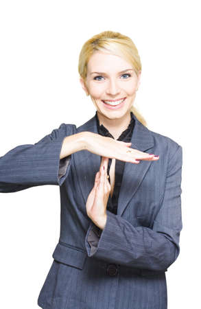 Business Woman Gestures A Pause For A Break Interval And Intermission By Placing Hands To Form The Letter T In A Corporate Time Out Or Timeout Conceptual photo