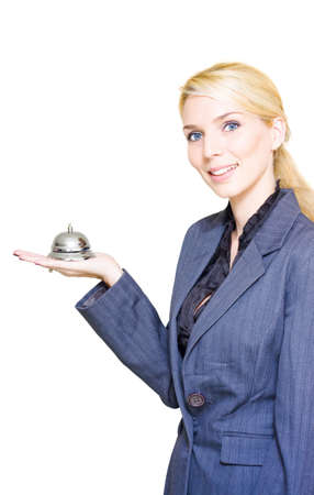 Business Customer Service Concept, Pretty Blonde Retail Assistant Store Manager Holding A Silver Service Bell With A Friendly Helpful Smile, White Background photo