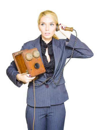 Vintage Business Call Center Operator Holding A Retro Wooden Box Telephone During An Old Fashion Conversation Of Good Old Customer Service And Helpful Advice photo