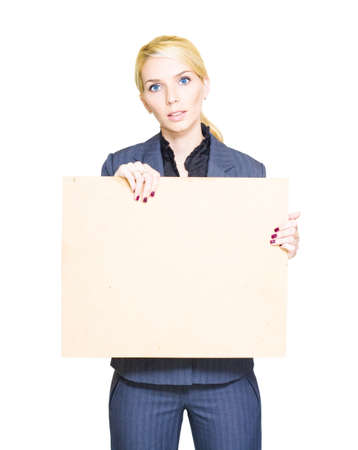 Attractive Professional Business Woman Holds Up A Blank Billboard Or Sign In A Commercial Communication Display Of Information And Marketing, Isolated On White Stock Photo - 13149641