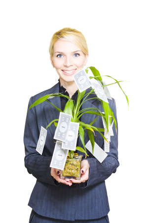 Rich And Wealthy Business Woman Smiling With An Expression Of Success While Holding A Cash Plant Growing One Dollar Notes In A Money Tree Conceptual photo