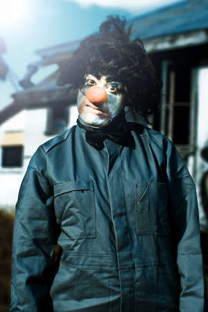 Half Body Portrait Of Scary Clown With Curl Black Wig Red Nose And Leather Style Coat Outdoors Stock Photo - 13178473