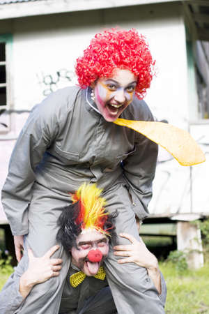 A Balancing Act Sees A Clown Riding On Another Clowns Back In A Playful Display Of Clowning Around Stock Photo - 13178335