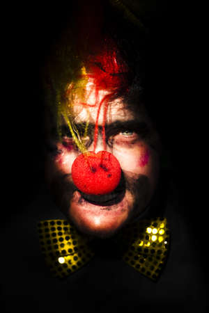 Eerie Clown Face Portrait With Big Red Nose And Gold Polka Dot Bow Tie On Black Background Stock Photo - 13177595