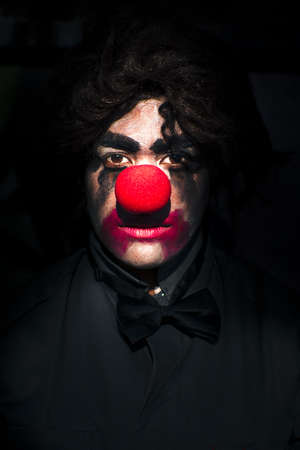 Scary Evil Clown With A Big Red Nose On A Dark Background Stock Photo - 13177941