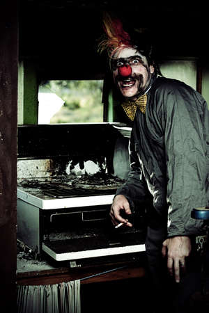 Mr Bungle The Kitchen Clown Stands Next To A Burnt Out Kitchen Stove In A Humorous Display Of Bad Cooking Stock Photo - 13178394