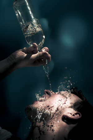 Falling Water Motion Action Capture On The Wet Face Of A Water Thirsty Man Needing A Summer Cool Down Drink Of Thirst Quenching H20 Water Stock Photo - 13177653
