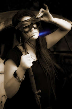 Gorgeous Brunette Female Mechanic Using A Industrial Welder With Blue Flame When Fabricating A Steel Car Frame Chassis In A Dark Creative Portrait photo