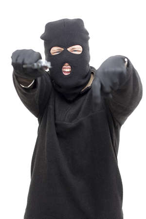 Armed Gunman Points Down While Directing His Pistol At The Camera Stock Photo - 13201119