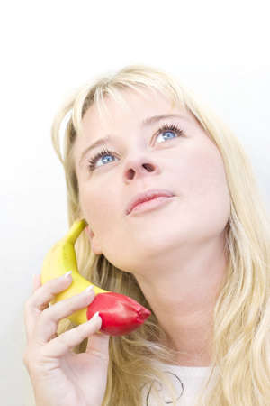 A Woman Looks Up While Chatting On A Cordless Banana Stock Photo - 13201127