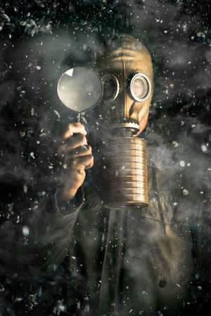 Scientist wearing a gas mask and holding a magnifying glass in a snow storm conducting research into the effects of gases, pollutants and carbon on climate change photo