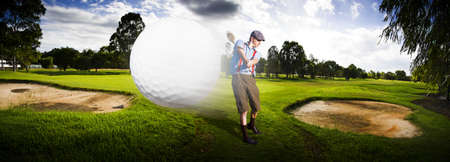 Sport Panorama Of A Vintage Golfer Hitting A Flying Golf Ball Mid Air On A Golfing Green In A Depiction Of Speed And Top Flight photo
