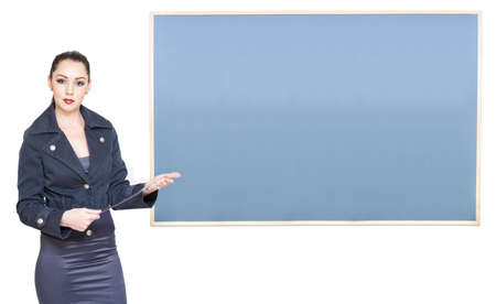 Education And Early Learning Concept With A School Teacher Standing Next To A Blank Blackboard With Copyspace Or Room For Text, On White Background Stock Photo - 13262093