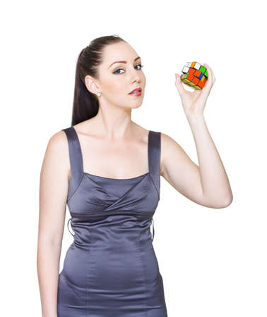 Young Brunette Business Lady Holding Unsolved Rubiks Cube Puzzle In A Depiction Of Troubleshooting, Problem Solving And Creative Solutions, Isolated On White photo
