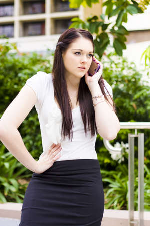 Irritated And Upset Business Woman Showing Displeased Body Language When Talking On A Mobile Phone Outdoors In A Unhappy Business Conceptual photo