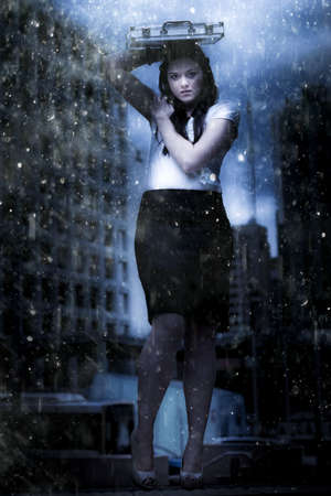 Art Design Photo Of A Business Woman On Dark City Street Caught In The Pouring Rain Of A Business Storm In A Metaphor Of Insurance Cover And Financial Dept Crisis photo