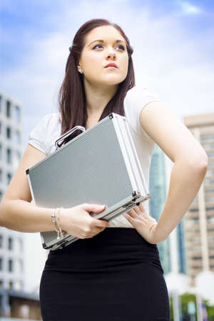 Cute Young Business Woman Standing Proud And With Confidence On An Urban Street In A Depiction Of Business Dreams Visions Aspirations And Goals Stock Photo - 13262239