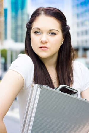 Attractive Female Architect Consultant With Brunette Hair Carrying Plans In Briefcase At City Location During An Onsite Building Inspection For Quality Assurance Stock Photo - 13262357