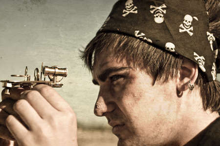 Grungy Textured Image Of A Male Pirate Profile Looking Through The Eye Piece On A Vintage Nautical Compass In A Maritime Conceptual Stock Photo - 13359821