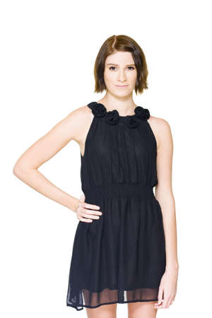 On White Picture Of A Unsure Hesitant And Shy Young Brunette Woman Trying On Black Formal Evening Outfit In A Pre Formal Nerves And Tension Concept Stock Photo - 13361048