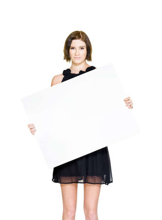 Female Holding Board Or Sign On A Slanted 45 Degree Angle While Promoting A Discount Special During A Stocktake Clearance Markdown Sale, On White photo