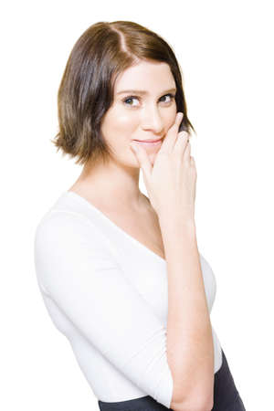 Studio Isolate Portrait Of A Beautiful Young Business Woman Gesturing A Smile By Pushing Lips Up In A Depiction Of Putting On A Happy Face, On White Background photo